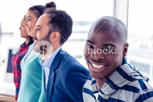 Portrait of happy businessman with colleagues
