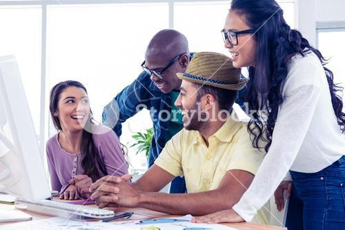 Business people laughing at desk