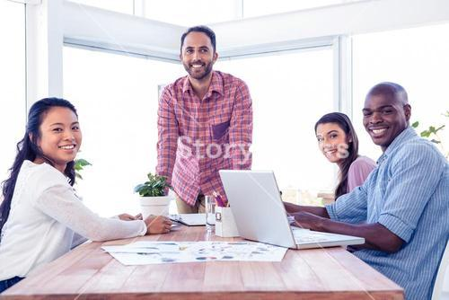 Happy multi ethnic business people in meeting room