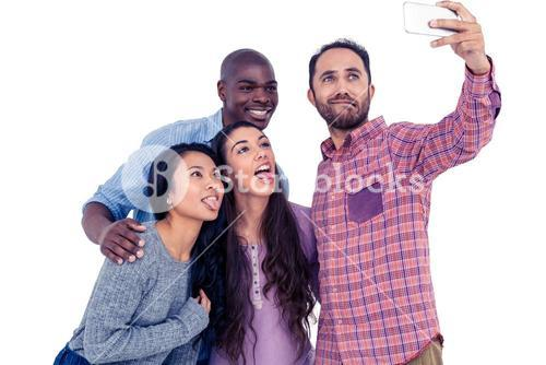 Multi-ethnic friends making face while taking selfie