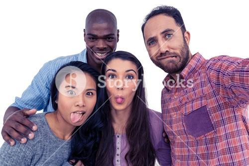 Happy multi-ethnic friends making a face