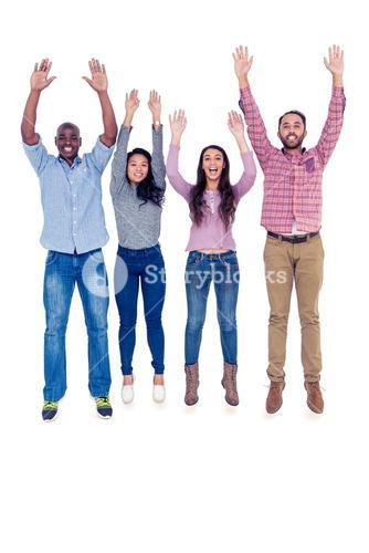 Friends jumping with arms raised