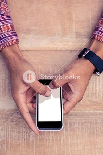 Person using smart phone on desk