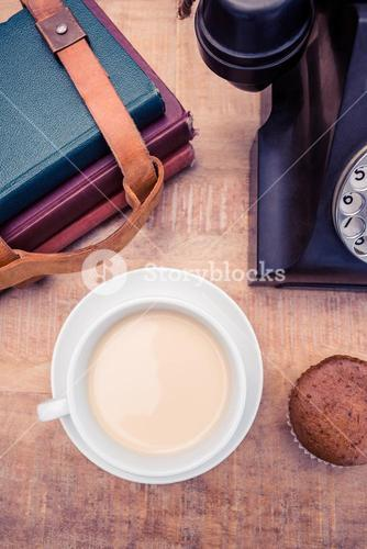 Coffee with old landline telephone and diaries