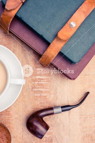 Coffee with diaries and smoking pipe