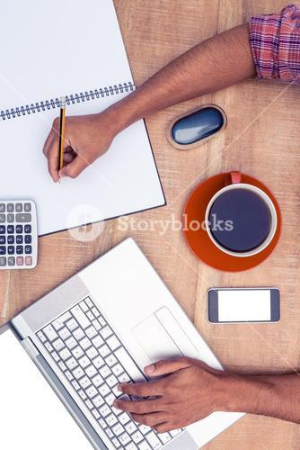Overhead view of businessman working in office
