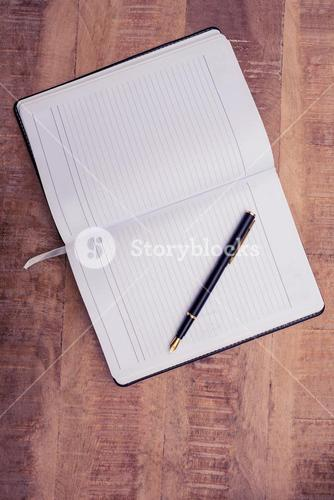 Overhead view of pen on open book