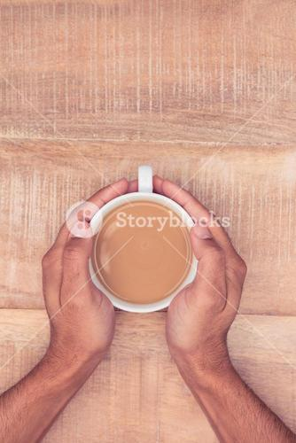 Directly above view of businessman hand holding coffee