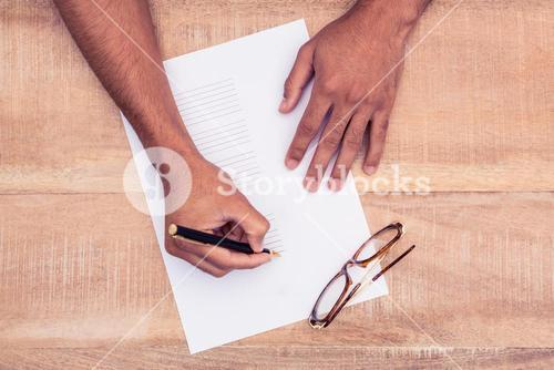 Businessman writing on paper