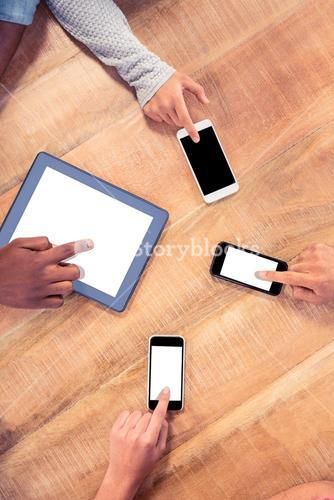 Business people using technologies at table