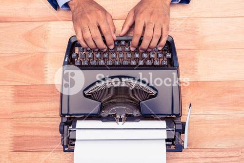High angle view of businessman typing on typewriter