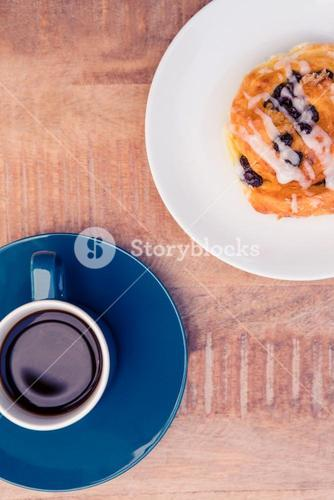 High angle view of sweet food served in plate by coffee cup on table