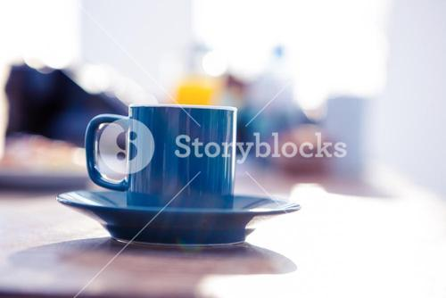 Coffee cup on table in office