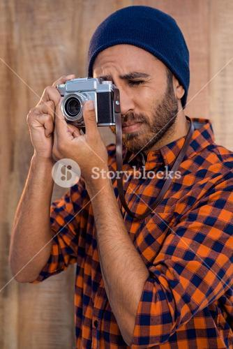 Hipster businessman photographing through camera