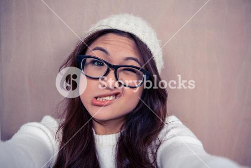 Asian woman making faces