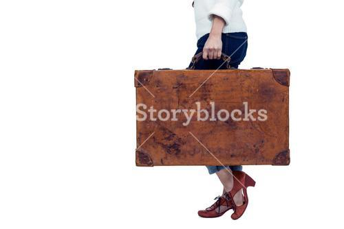 Midsection of woman holding luggage