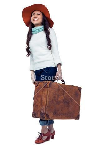 Asian woman with hat holding luggage