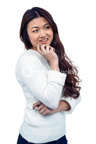 Smiling Asian woman with hand on chin