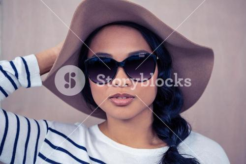 Attractive Asian woman with hat and sunglasses