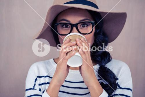 Attractive Asian woman drinking by disposable cup