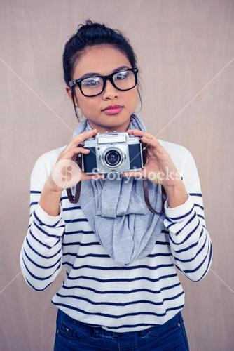 Attractive Asian woman holding camera