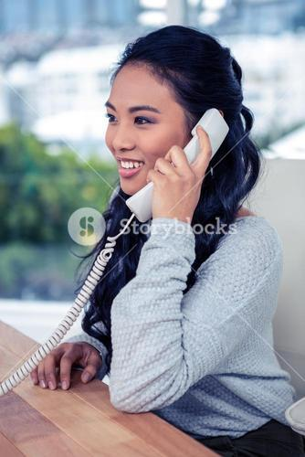 Smiling Asian woman on phone call