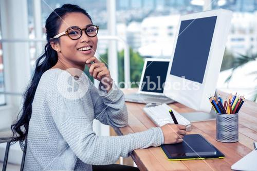 Smiling Asian woman using digital board with finger on chin