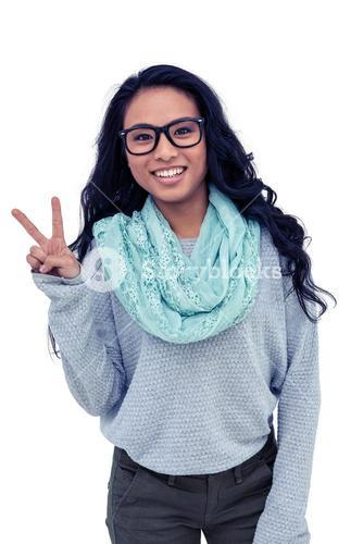 Asian woman making peace sign with hand
