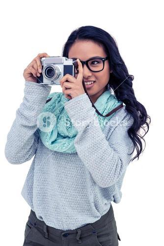 Asian woman taking picture with digital camera