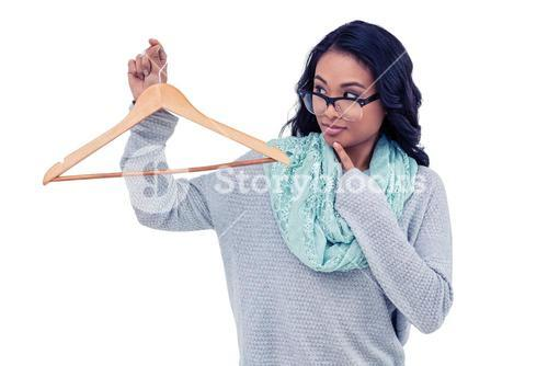 Asian woman holding wooden hanger