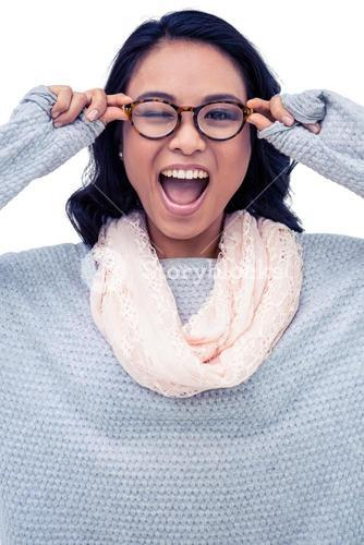 Asian woman holding eyeglasses