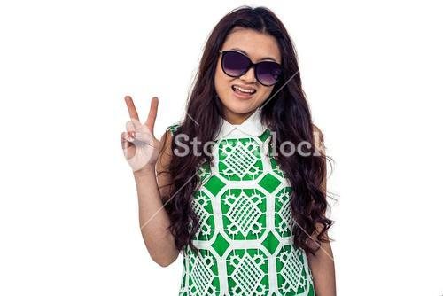 Asian woman with sunglasses making peace sign