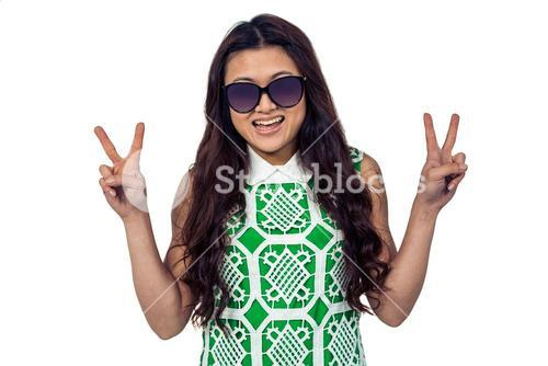 Asian woman making peace sign with hands