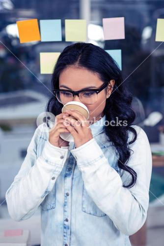 Asian woman drinking by disposable cup