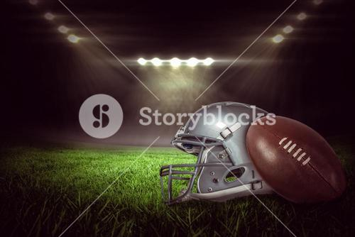 Composite image of american football helmet and ball