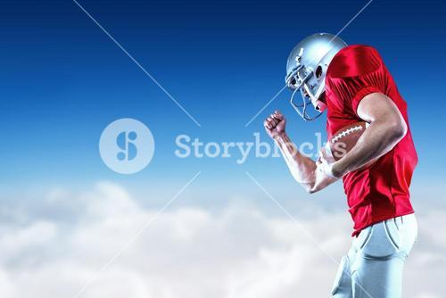 Composite image of american football player in mid-air