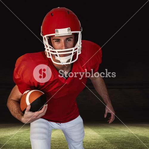 Composite image of rugby player with ball posing
