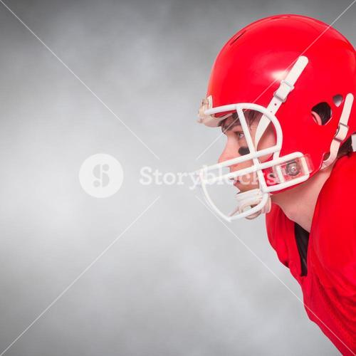 Composite image of american football player wearing a helmet