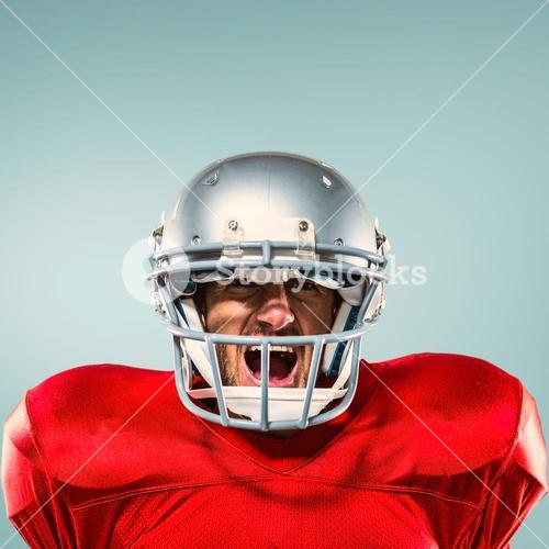Composite image of aggressive american football player in red jersey screaming