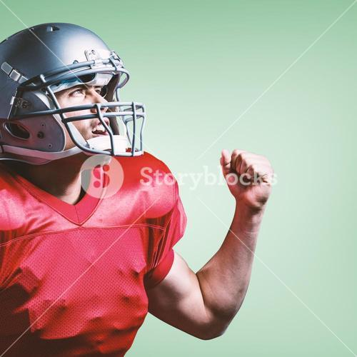 Composite image of american football player cheering with clenched fist