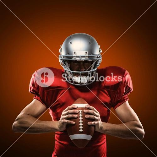Composite image of american football player in red jersey and helmet holding ball