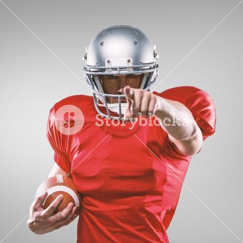 Composite image of portrait sports player in red jersey pointing