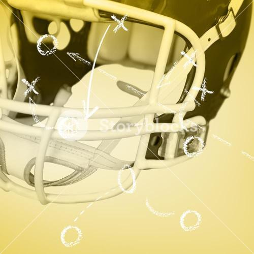Composite image of an american football helmet on the field