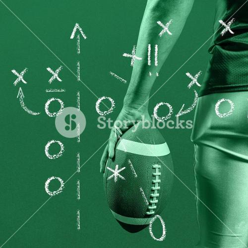 Composite image of cropped image of american football player holding ball