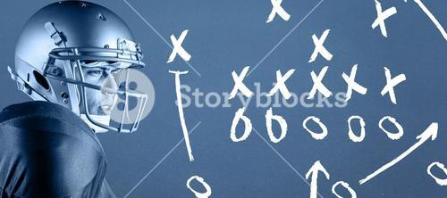 Composite image of side view of american football player looking away