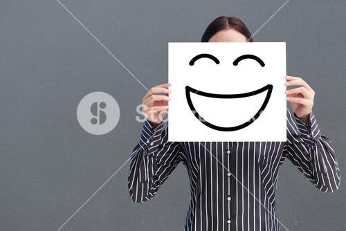 Composite image of smiling woman showing a big business card in front of her face