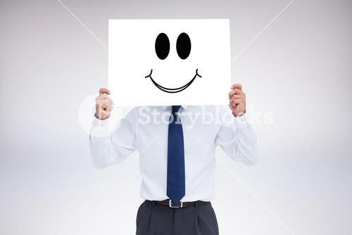 Composite image of tradesman holding blank sign in front of his head