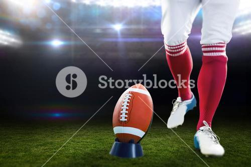 Composite image of american football player being about to kick football