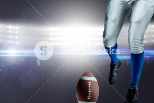 Composite image of low section of american football player kicking ball