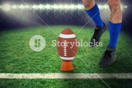 Composite image of american football player being about to kick ball